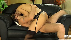 Petite brunette Irene blows Rolf's dick and has him pounding her twat