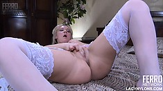 Busty blonde in white stockings Sandy pleases her twat with her fingers